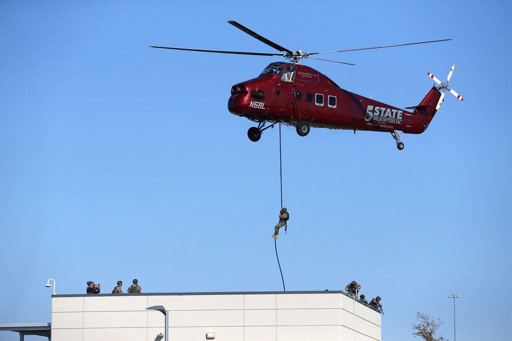 A Plano SWAT officer does fast-rope training onto a staging building at Toyota headquarters in Plano, Texas, on Monday, Nov. 19, 2018.