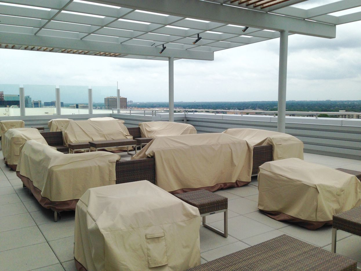 The rooftop deck at Stream Energy's Addison building has its furniture covered because of the rainy weather this weekend.