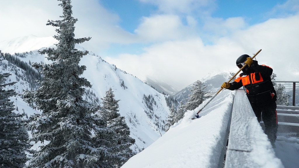 Workers have a new winter chore at Colorado's Aspen Highlands: scraping the snow off the solar panels.
