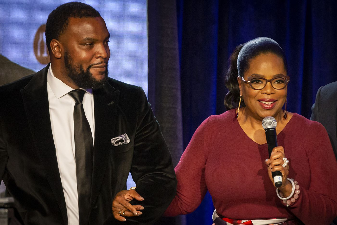 Civil rights attorney Lee Merritt takes the stage with Oprah Winfrey to pledge a $20,000 donation during the Minnie's Food Pantry 10th Anniversary 'Feed Just One Gala' at the Omni Frisco Hotel on Tuesday, April 3, 2018, in Frisco.