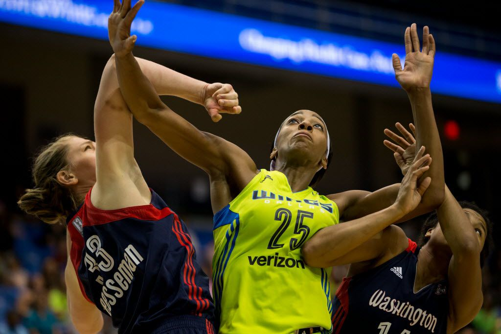Dallas Wings forward Glory Johnson (25) and Washington Mystics center Emma Meesseman (33) fights for a position for a free throw rebound during the second half of a WNBA basketball game at College Park Center on June 8, 2016 in Arlington. Wings lost 79-87. (Ting Shen/The Dallas Morning News)