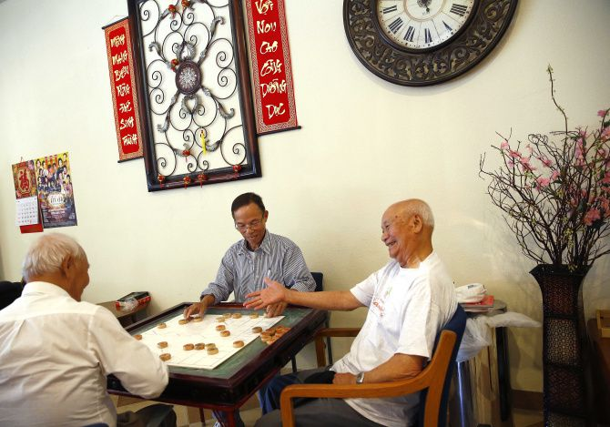 Playing Chinese chess is a chance to relax for (from left) Chuc Dao, Bryant Wilson and Thoi Bui at the Texas Golden Age Adult Day Care Center in Arlington.