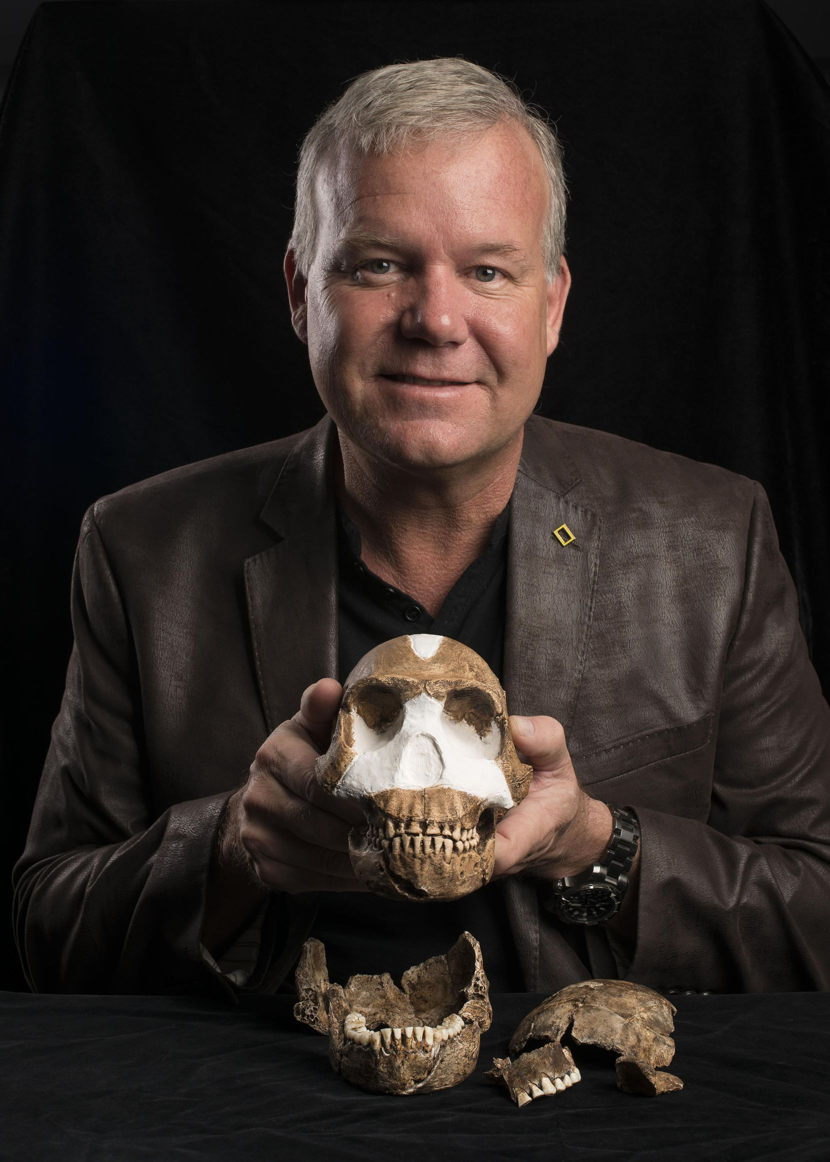 Professor Lee Berger with Homo naledi, estimated to be around 300,000 years old.