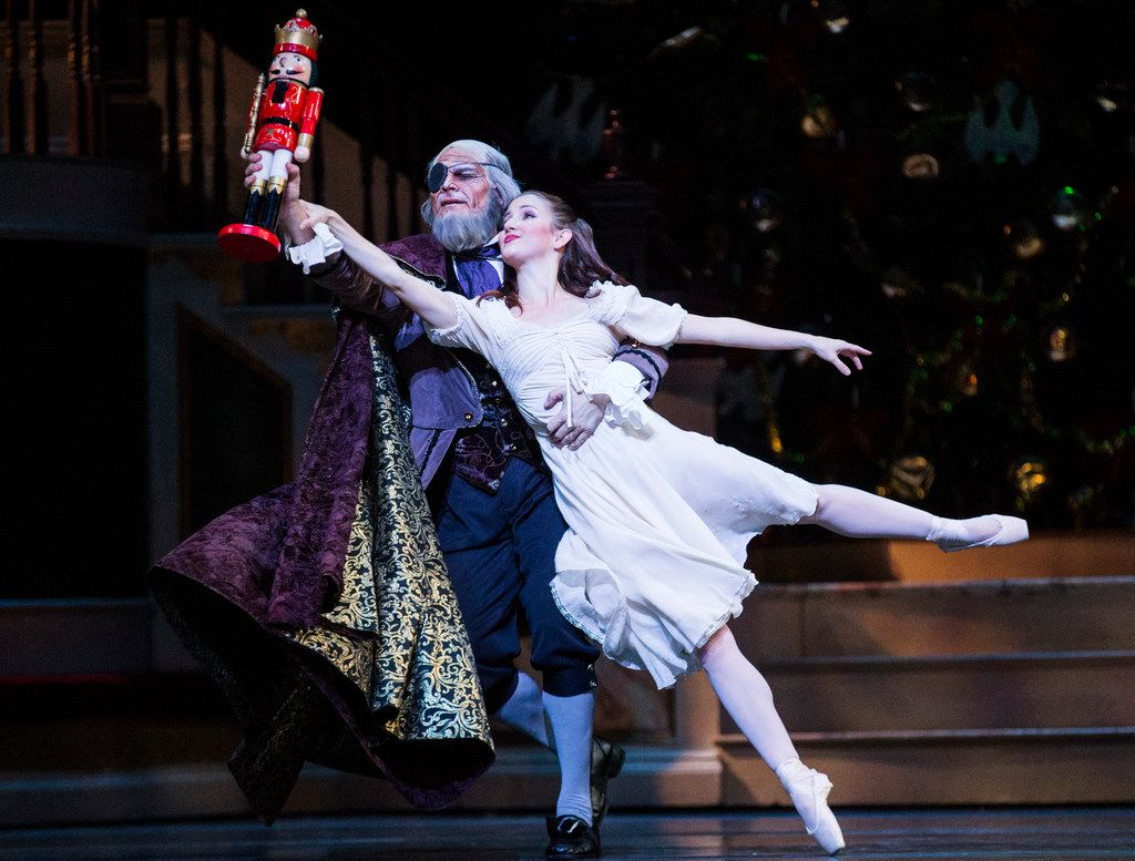 Carl Coomer portrays Herr Drosselmeyer and Charis Alimanova is Clara in Texas Ballet Theater's production of The Nutcracker at Winspear Opera House.