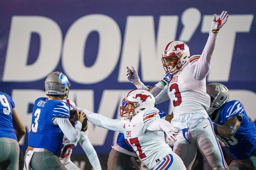 SMU defensive end Turner Coxe (97) and linebacker Delano Robinson (3) apply pressure to Memphis quarterback Brady White (3) during the second half of an NCAA football game at Liberty Bowl Memorial Stadium on Saturday, Nov. 2, 2019, in Memphis, Tenn. (Smiley N. Pool/The Dallas Morning News)