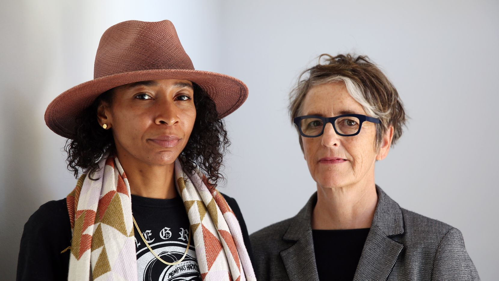 Artist Lauren Woods, left, and curator Kimberli Meyer, right, stand for a portrait at the Beall Center for Art + Technology at the University of California, Irvine on Oct. 1, where their work is on display.