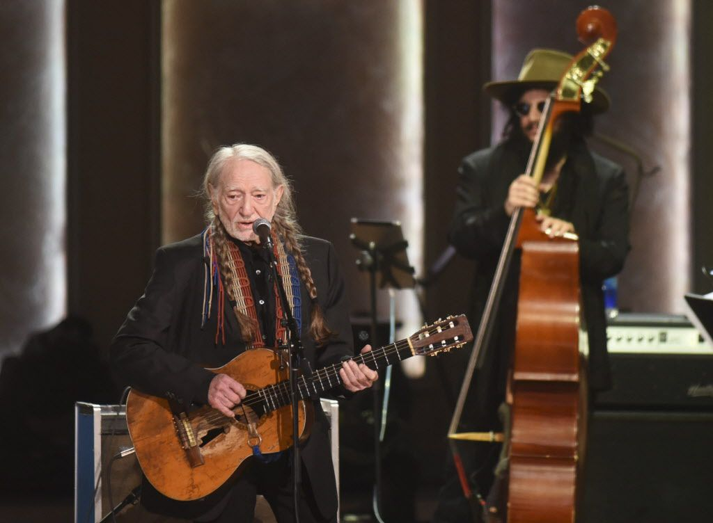 Willie Nelson sings after being presented with the 2015 Library of Congress Gershwin Prize for Popular Song on Wednesday, Nov. 18, 2015 in Washington. (AP Photo/Kevin Wolf)