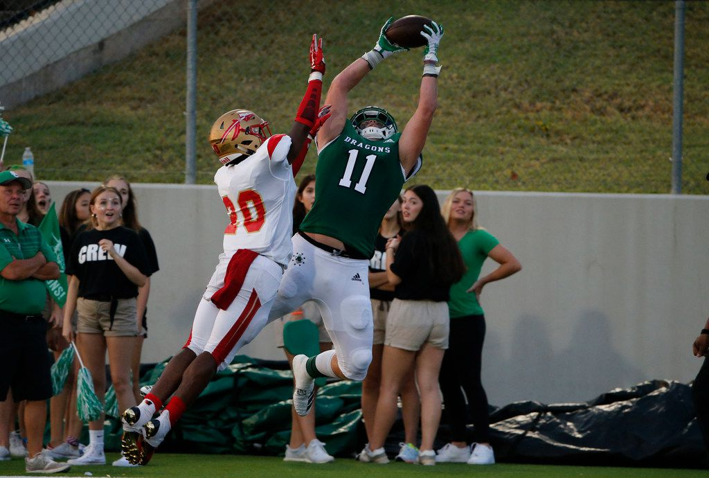 Southlake Carroll's Blake Smith (11) catches a touchdown pass over South Grand Prairie's Jalon Williams (20) during the first half of their high school football game in Southlake Texas on August 30, 2019. (Michael Ainsworth/Special Contributor)