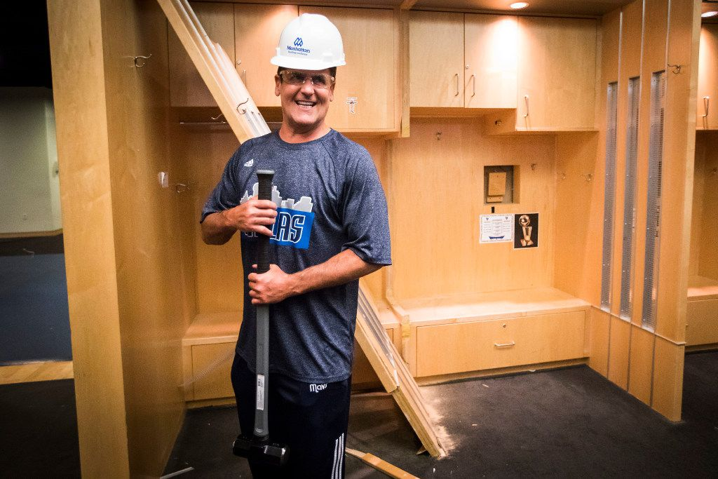 Dallas Mavericks owner Mark Cuban poses with a sledgehammer takes after he began the demolition process of the Mavericks locker room during a press availability before the 2017 NBA Draft at American Airlines Center on Thursday,June 22, 2017, in Dallas. The team is renovating the locker room into a state-of-the-art facility for the start of next season. (Smiley N. Pool/The Dallas Morning News)
