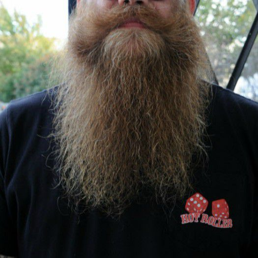 Troy Martin competes in a full beard natural competition.