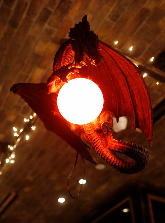 A dragon light fixture, one of many at the Ill Minster Pub in Dallas
