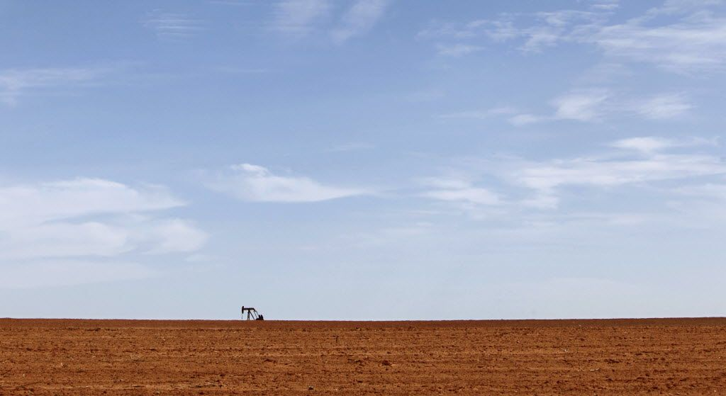 A pumpjack sits on the West Texas horizon.