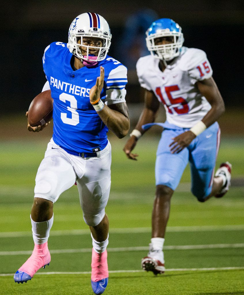 Duncanville quarterback Ja'Quinden Jackson (3) runs the ball against Skyline linebacker Brandon Stegall (15) during the second quarter of a high school football game between Skyline and Duncanville on Friday, October 4, 2019 at Panther Stadium in Duncanville. (Ashley Landis/The Dallas Morning News)