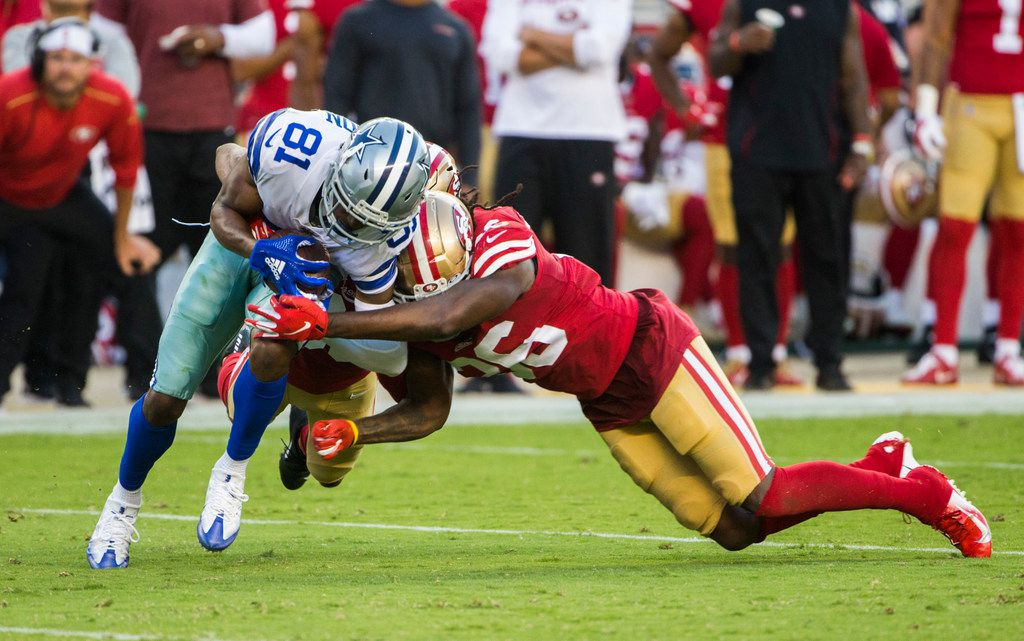 Dallas Cowboys wide receiver Jon'Vea Johnson (81) is tackled by San Francisco 49ers cornerback Greg Mabin (30) and defensive back Marcell Harris (36) during the second quarter of an NFL preseason game between the Dallas Cowboys and the San Francisco 49ers on Saturday, August 10, 2019 at Levi's Stadium in Santa Clara, California. (Ashley Landis/The Dallas Morning News)