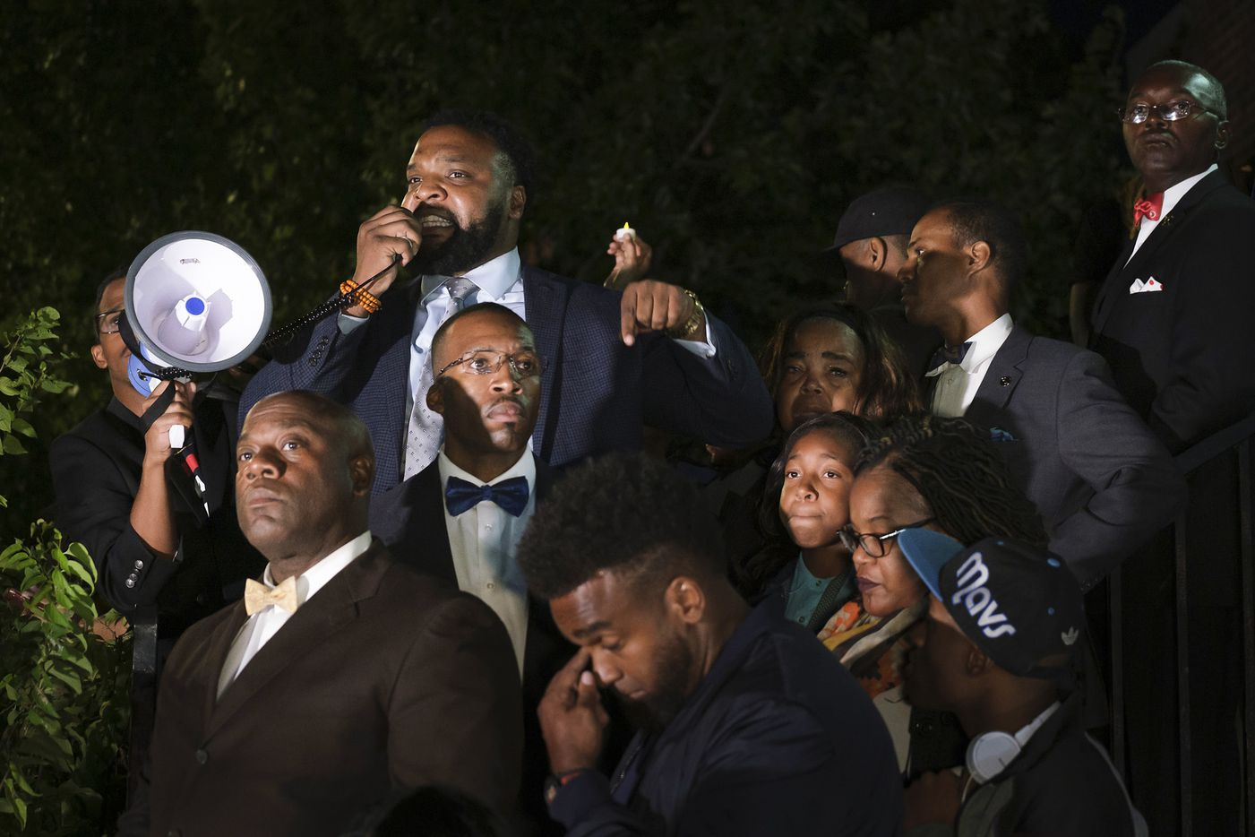 Attorney Lee Merritt stands with members of the victimÕs family as he addresses a community vigil for Atatiana Jefferson  on Sunday, Oct. 13, 2019, in Fort Worth.