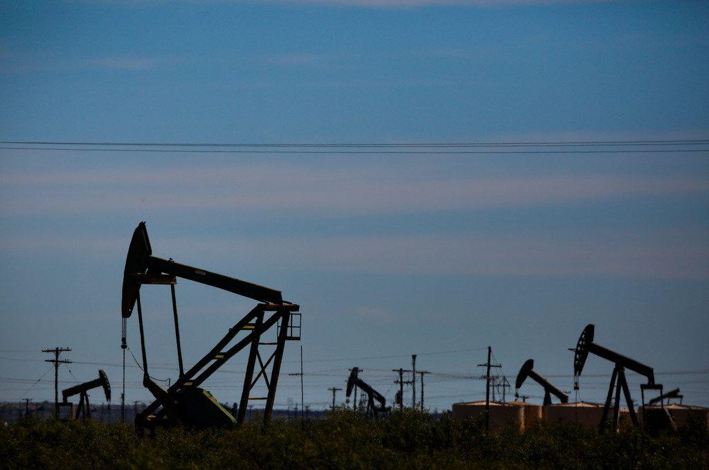 Oil pumpjacks line the horizon just west of Penwell, Texas on Nov. 2, 2018.