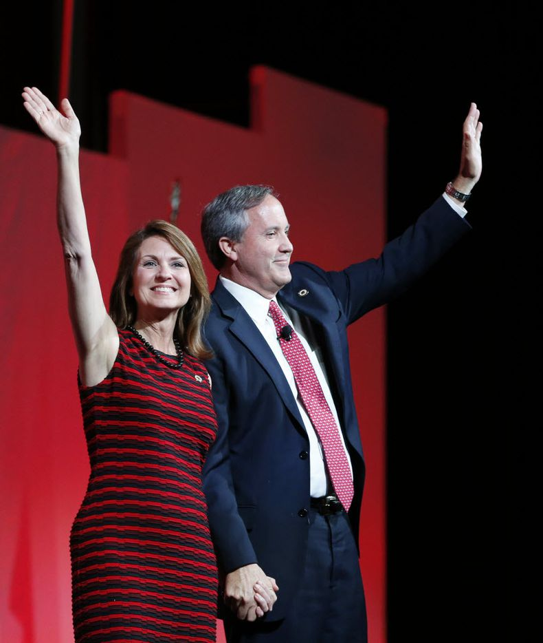 Texas Attorney General Ken Paxton and wife Angela wave to the crowd during the 2016 Texas Republican Convention at the Kay Bailey Hutchison Convention Center in Dallas.