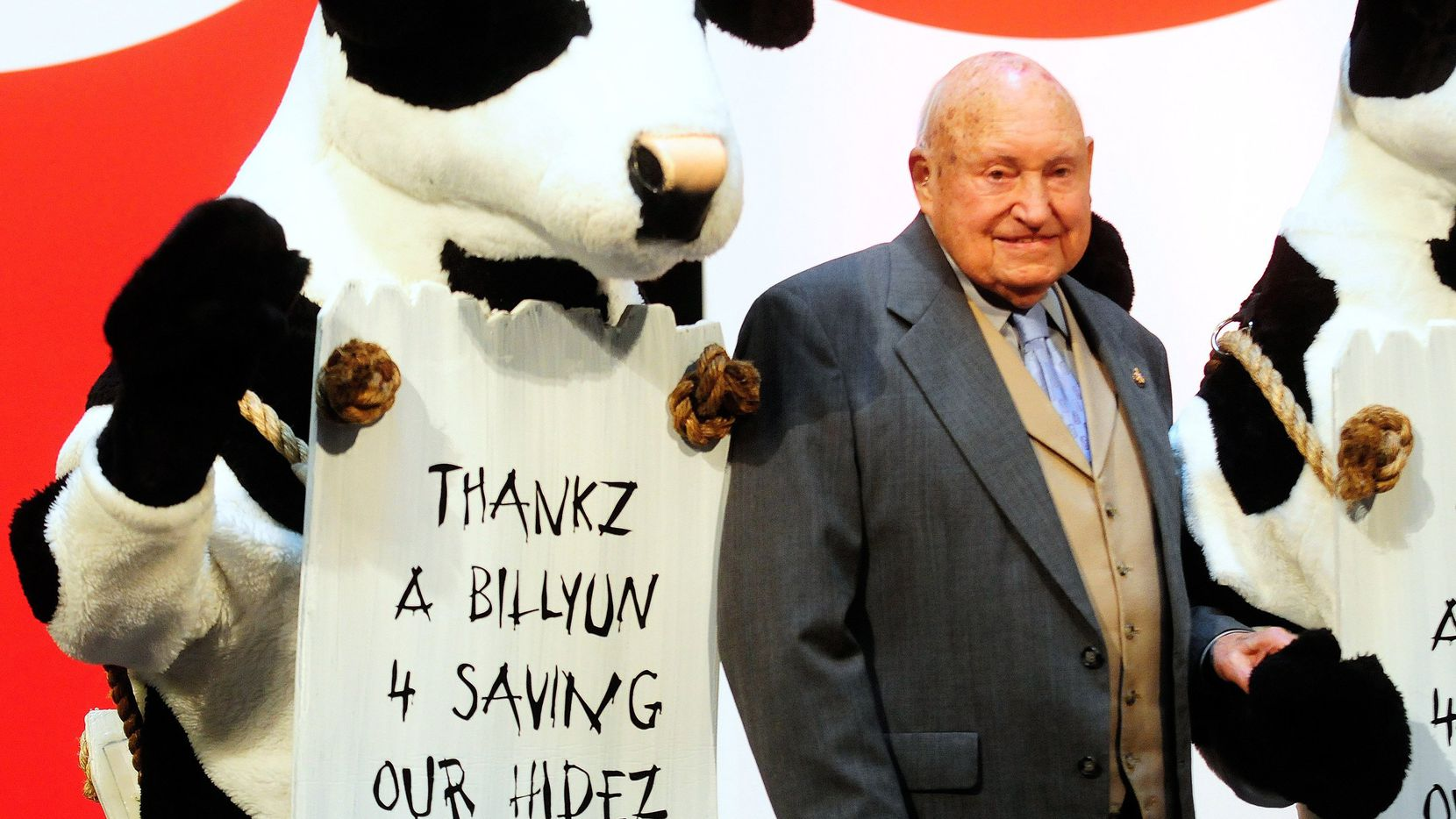"""The late Truett Cathy and his family celebrated a sales milestone in 2009 at Chick-fil-A's Atlanta headquarters with several of the brand's signature cows.  Chick-fil-A has ended its 22-year relationship with The Richards Group, which helped the chicken chain rise to fame with the """"Eat Mor Chikin"""" campaign. (Elissa Eubanks/Atlanta Journal-Constitution, File Photo)"""