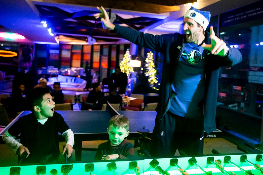 Dallas Mavericks forward Dirk Nowitzki reacts after scoring a goal in a game of foosball during the Dallas Mavericks annual Dinner with Santa Scout at The Statler hotel in Dallas on Friday, December 7, 2018. (Shaban Athuman/The Dallas Morning News)