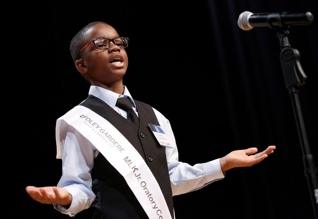 Tory Robertson Jr., a fifth-grader at Clara Oliver Elementary School, delivers his second-place speech before an audience at Adamson High School in Dallas.