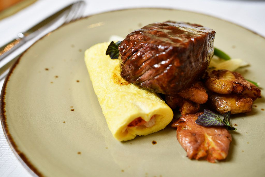 Cognac pepper glazed filet mignon and petite creamy lobster omelet with crispy confit potatoes served on the Mother's Day menu from Fearing's restaurant in Dallas, April 26, 2019.