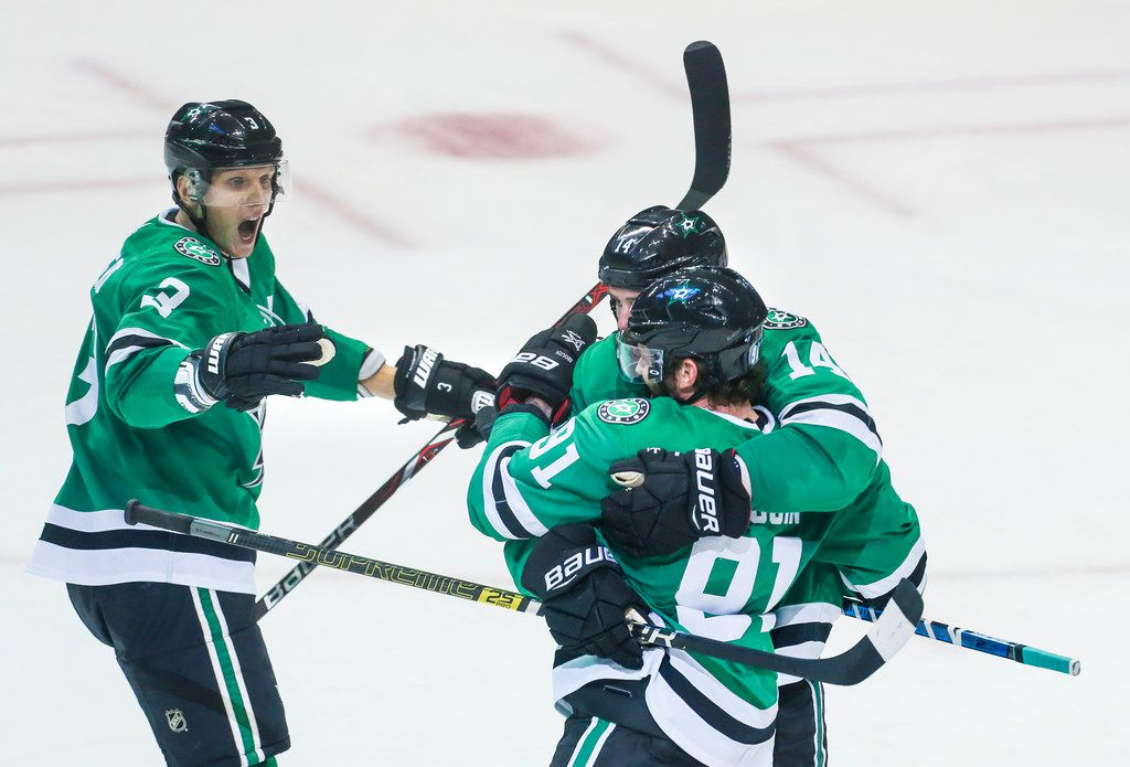 Dallas Stars left wing Jamie Benn (14), center Tyler Seguin (91) and defenseman John Klingberg (3) celebrate a goal during the second period of a game between the Dallas Stars and the Winnipeg Jets on Saturday, Oct. 6, 2018 at American Airlines Center in Dallas. (Ryan Michalesko/The Dallas Morning News)