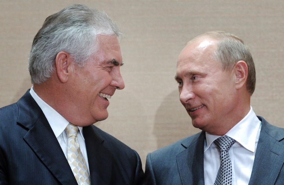 Exxon chief executive Rex Tillerson (left) will face questions about his relationship with Russian President Vladimir Putin as Tillerson tries to win confirmation to be  secretary of state. (Alexei Druzhinin/RIA Novosti)