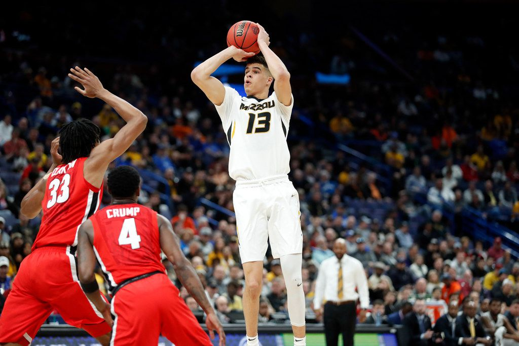 Missouri's Michael Porter Jr. shoots over Georgia's Nicolas Claxton (33) and Tyree Crump (4) during the first half in an NCAA college basketball game at the Southeastern Conference tournament Thursday, March 8, 2018, in St. Louis. (AP Photo/Jeff Roberson) ORG XMIT: MOJR
