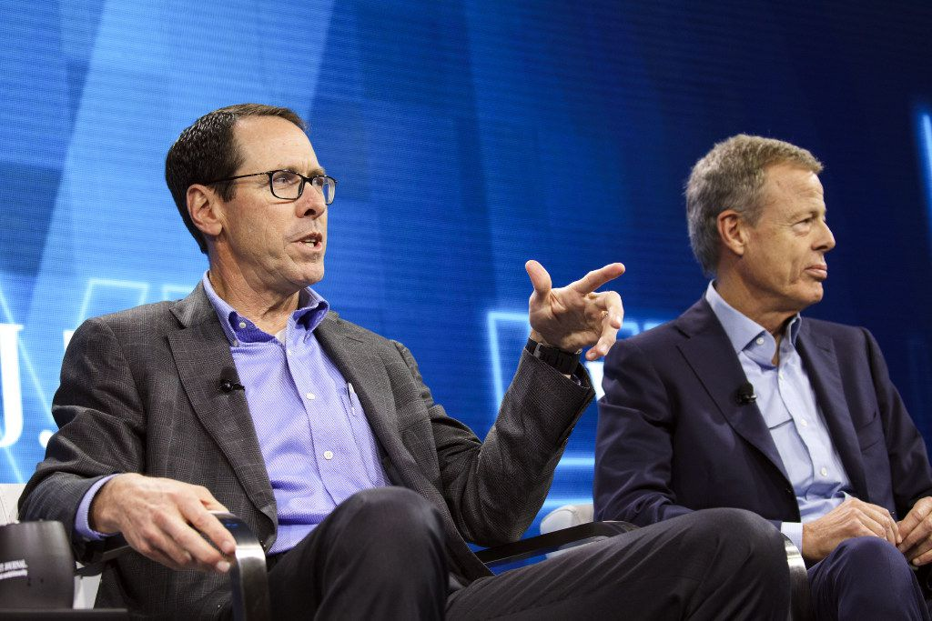 "Randall Stephenson, chairman and chief executive officer of AT&T Inc., left, speaks while Jeffrey ""Jeff"" Bewkes, chairman and chief executive officer of Time Warner Inc., listens during the WSJDLive Global Technology Conference in Laguna Beach, California, U.S., on Tuesday, Oct. 25, 2016. The conference brings together an unmatched group of top CEOs, founders, pioneers, investors and luminaries to explore tech opportunities emerging around the world. Photographer: Patrick T. Fallon/Bloomberg"