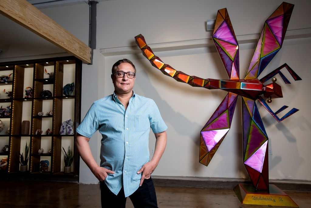 Jorge Baldor, founder of Mercado Artesanal, in front of Libelula, a sculpture by Oaxacan artist Fernando Andriacci, at Mercado Artesanal on Jefferson Boulevard in Dallas.  Baldor, who was born in Cuba but raised in Oak Cliff, opened the gallery to provide a unique cultural experience by featuring handcrafted works from Latin America.  (Jeffrey McWhorter/Special Contributor)