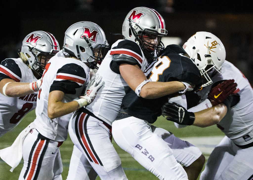 Arlington Bowie wide receiver Jimmy Valsin (18) is tackled by Flower Mound Marcus defenders during the fourth quarter of a high school football game between Flower Mound Marcus and Arlington Bowie on Thursday, August 29, 2019 at Wilemon Field in Arlington. (Ashley Landis/The Dallas Morning News)