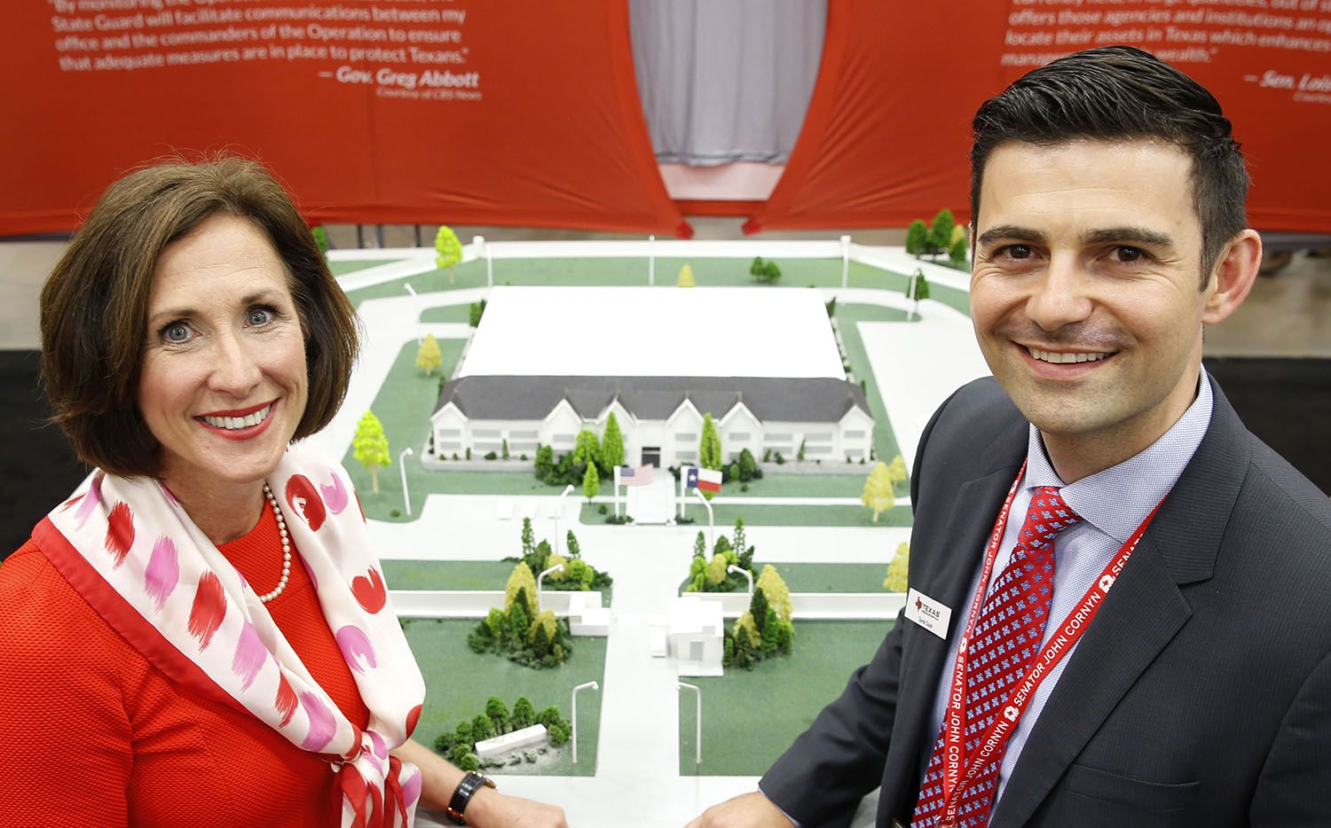 Sen. Lois Kolkhorst, R-Brenham, and Tarek Saab, chief operating officer of Texas Precious Metals, both attending the state GOP convention in Dallas, stand next to an architectural model of a planned Texas Bullion Depository. Lawmakers approved Kolkhorst's bill to create the depository last year. (Vernon Bryant/Staff Photographer)