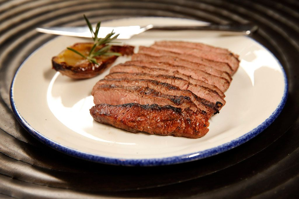 A sous vide flat iron steak prepared on a wood fired-grill at Knife Modern Steakhouse in Dallas.