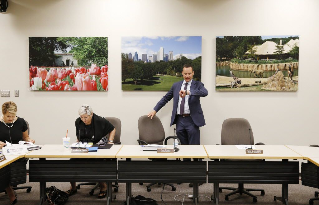 Brodsky checks his watch before leading a Dallas Animal Commission meeting at City Hall on Aug. 4.