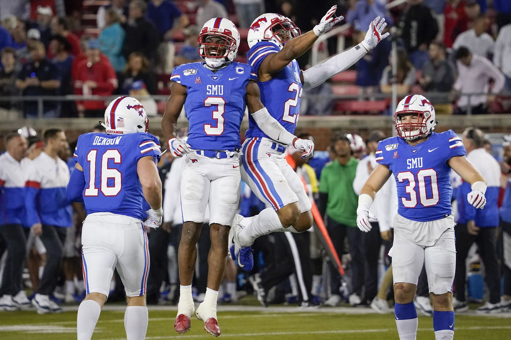 SMU wide receiver James Proche (3) celebrates with safety Rodney Clemons (23) after Proche recovered a Tulane onside kickoff during the second half of an NCAA football game at Ford Stadium on Saturday, Nov. 30, 2019, in Dallas.