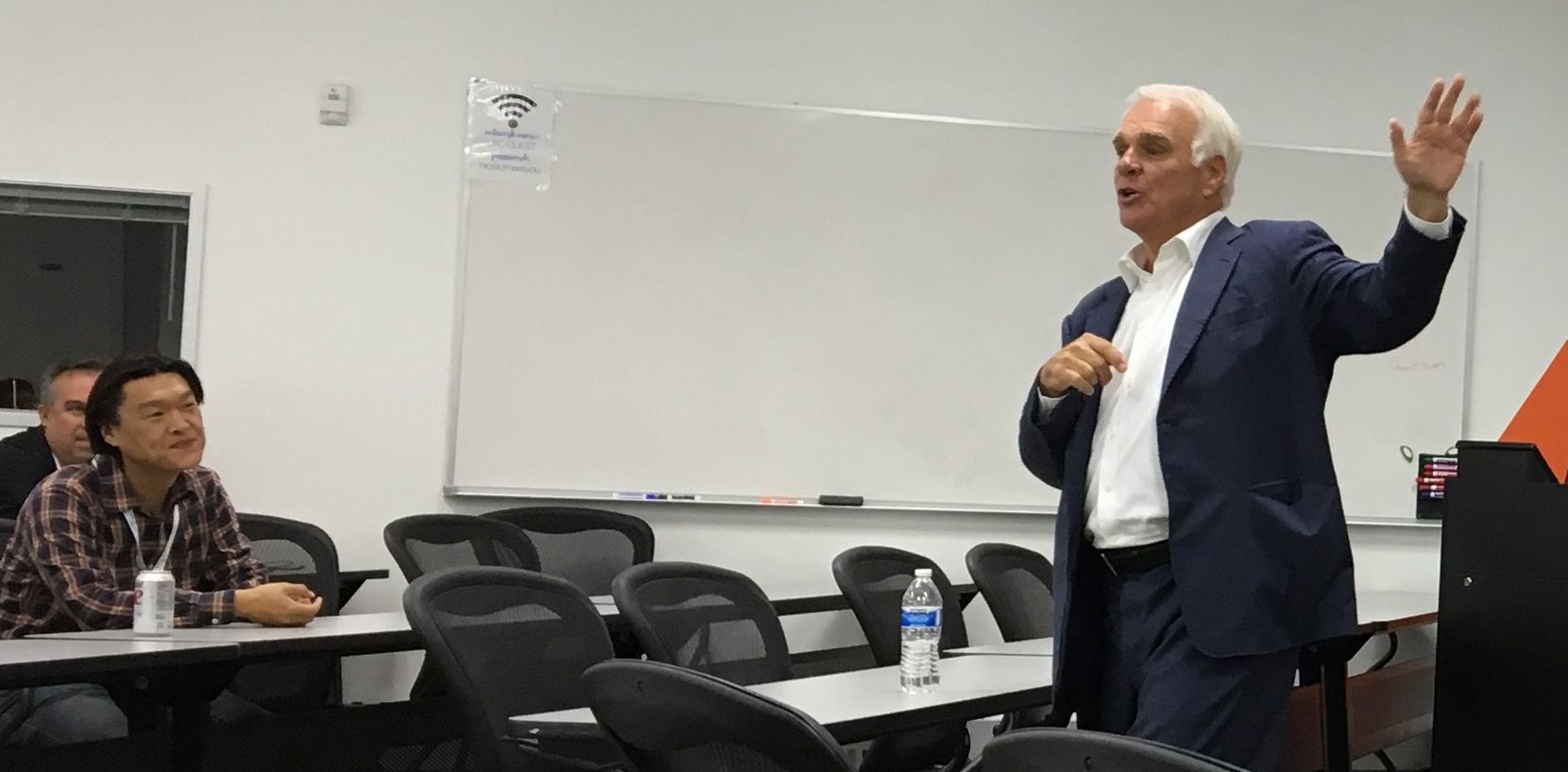 Dallas Stars CEO Jim Lites talks with entrepreneurs as part of a business accelerator program offered through Stadia Ventures.