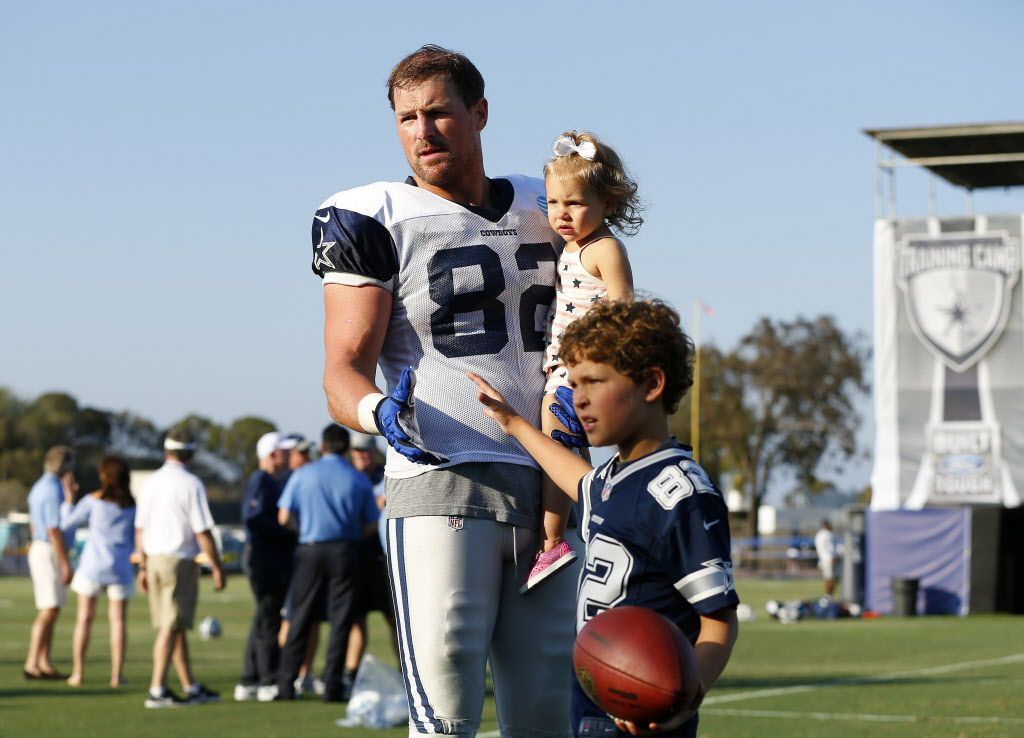Dallas Cowboys tight end Jason Witten (82) plays with his kids following afternoon practice at training camp in Oxnard, California, Tuesday, August 9, 2016. Here he is holding his 1 yr-old daughter Hadley while his son Cooper plays with a football. (Tom Fox/The Dallas Morning News)