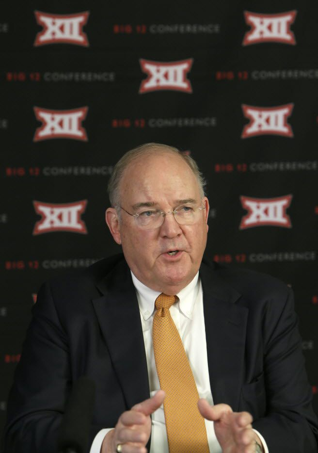 Texas Athletic Director Mike Perrin speaks to reporters after the Big 12 conference meeting Thursday, Feb. 4, 2016, in Irving, Texas. (AP Photo/LM Otero)