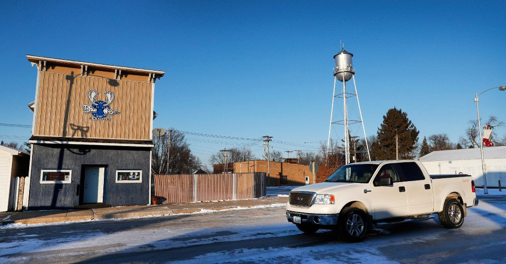 A pickup passes the Blue Moose Saloon which opened in September in Renwick, Iowa, on Tuesday, Dec. 13, 2016. (AP Photo/Charlie Neibergall)