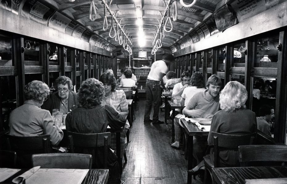 This 1983 file photo shows diners eating dinner in the trolley at Spaghetti Warehouse in Dallas' West End.