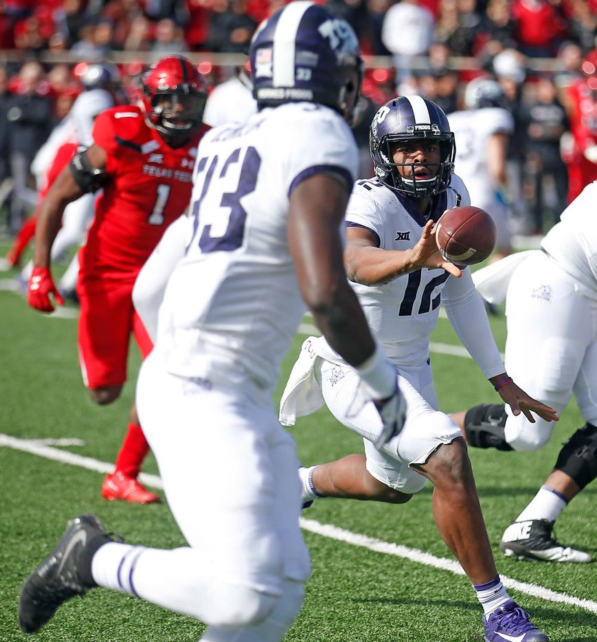 TCU's Shawn Robinson (12) pitches the ball to Sewo Olonilua (33) during the first half of the NCAA college football game against Texas Tech, Saturday, Nov. 18, 2017, in Lubbock, Texas. (AP Photo/Brad Tollefson)