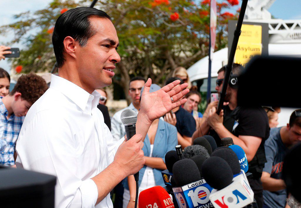 Democratic presidential hopeful Julián Castro addresses the media about migrant children in front of a detention center in Homestead, Fla.