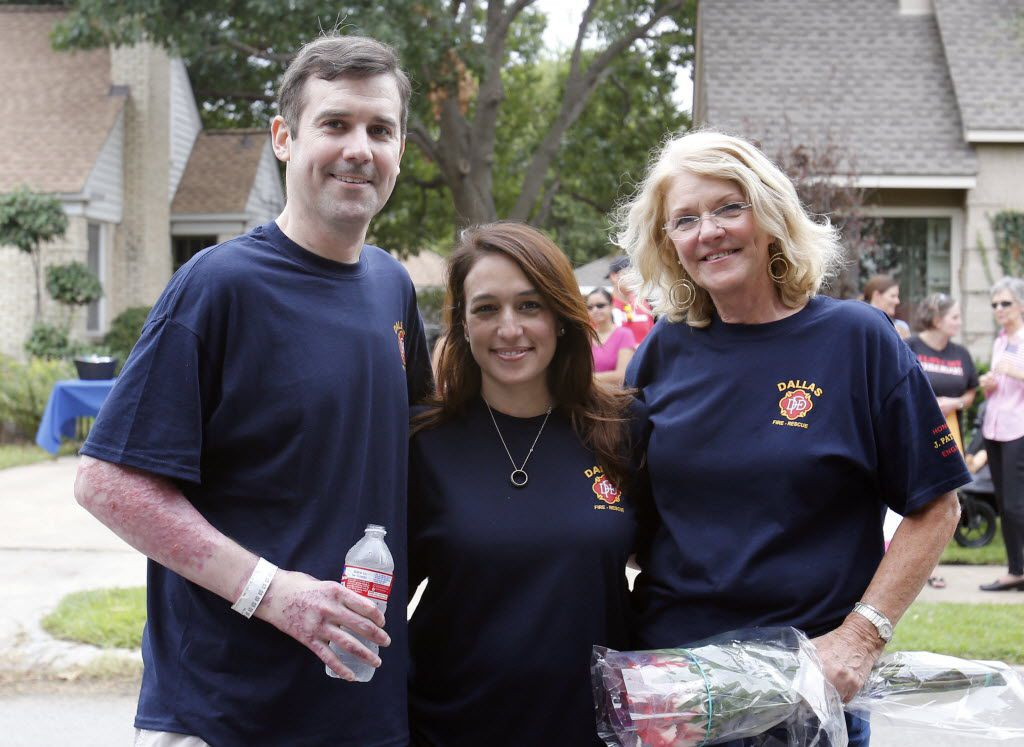 Dallas firefighter Jeff Patterson, wife Tina Hernandez, and mother Carolyn Beall during a welcome home celebration at his house in Dallas on Sept. 19, 2014. Patterson was critically injured battling a house fire.