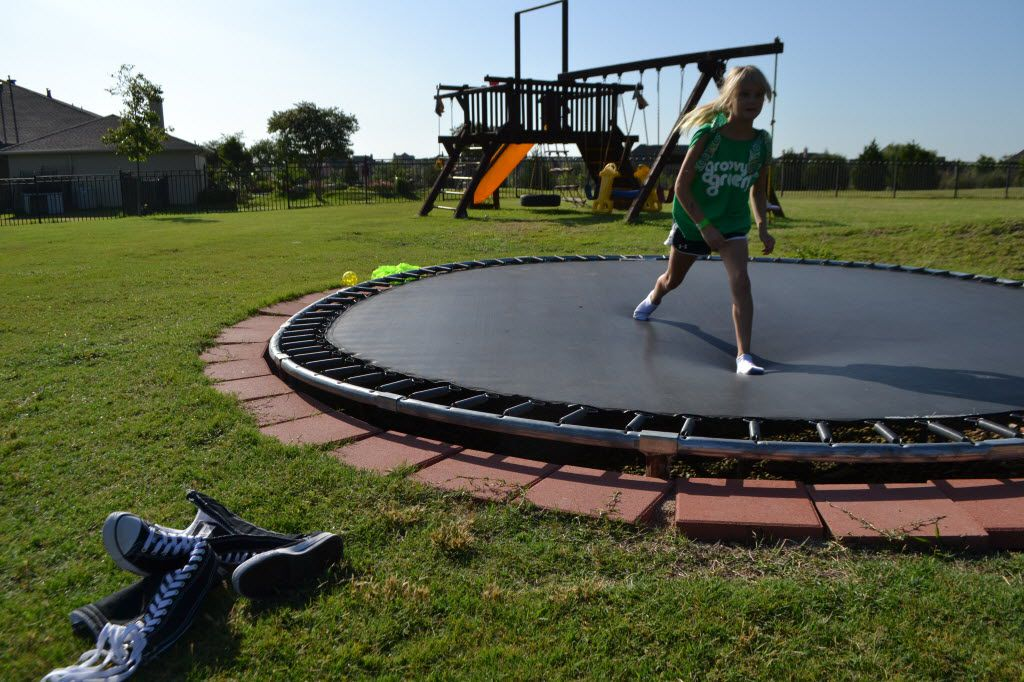 Sydney Hail plays on the trampoline in the backyard of her family's home in the Stoneleigh subdivision in Heath. Stoneleigh and other subdivisions in east Heath are in a part of Rockwall County that ranked as the best neighborhood overall in the Rockwall-Rowlett area, according to an analysis by The Dallas Morning News.