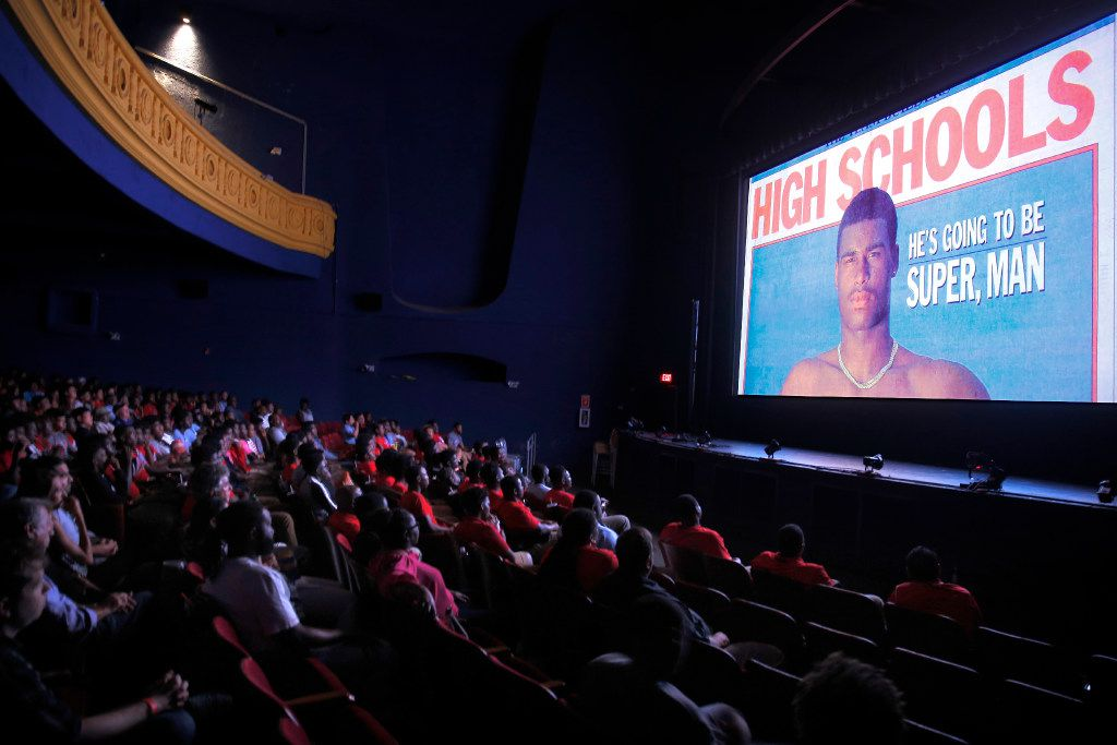 The Carter High and Oak Cliff community watches the premier of What Carter Lost, an ESPN documentary about the 1988 Carter football team shown at the Texas Theatre in Dallas, Wednesday, August 16, 2017. Former star athlete Jessie Armstead is pictured on screen during the movie. (Tom Fox/The Dallas Morning News)