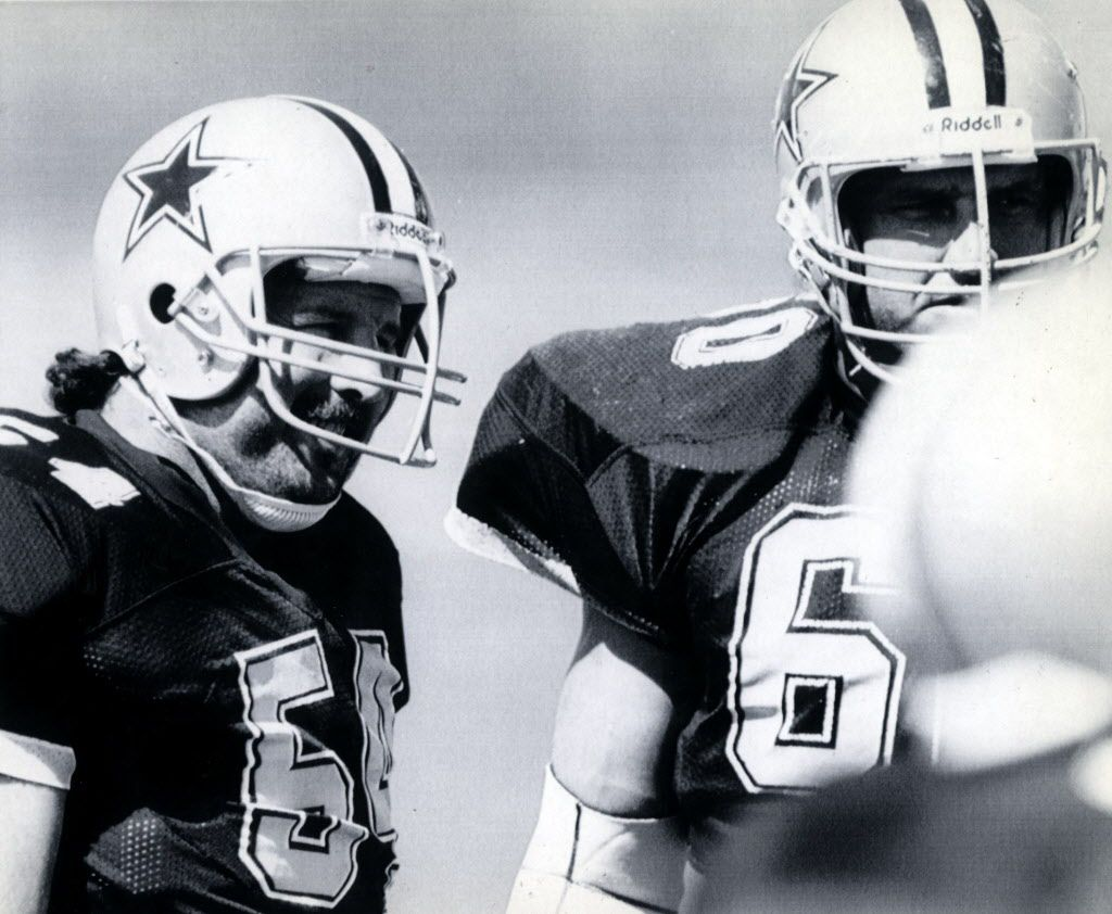 Dallas Cowboys' defensive tackles Randy White, left, and Don Smerek, veterans who said that they couldn't afford the strike, attend practice at the Dallas Cowboys facility in Irving, Texas.