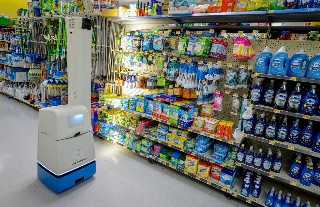 A robotic shelf scanner moves along an aisle at a North Richland Hills Walmart on April 5, 2019.
