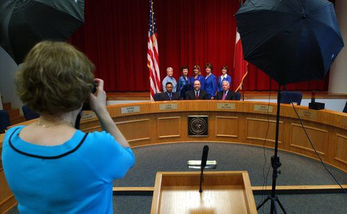 David Tyson Jr. (left in front row) posed with the Richardson school board in 2005. Thirteen years later, he is suing the current board, alleging a pattern of open meetings violations going back 15 years or more.