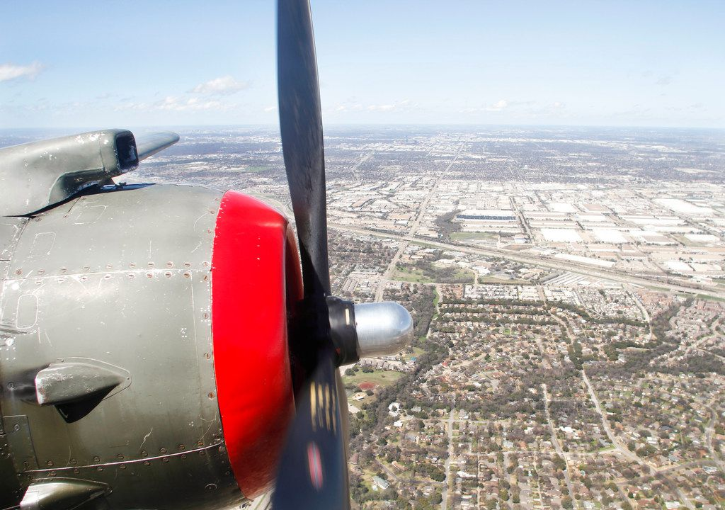 The left propeller of a North American B-25 Mitchell Bomber rotates as the plane flies over North Texas during a media flight on Wednesday, March 13, 2019. The bomber is part of Collins Foundation's Wings of Freedom Tour at the Frontiers of Flight Museum.