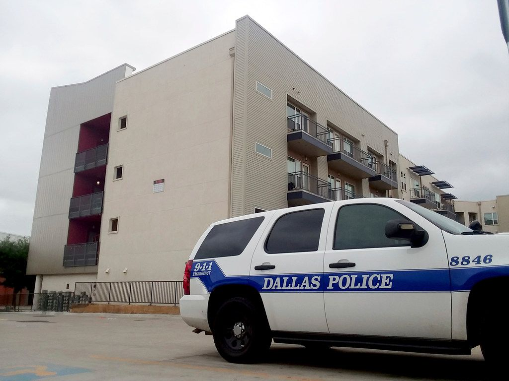 A police vehicle was parked near the South Side Flats apartments on Monday, a few days after Botham Jean was shot inside his apartment there.
